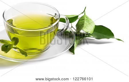Cup of tea and tea leaves isolated on white