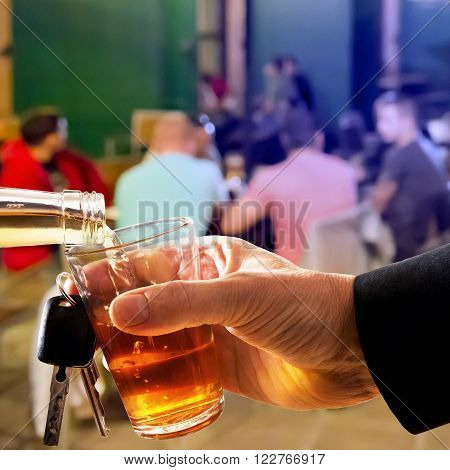 hard drinker with liqueur glass and car key in the bar