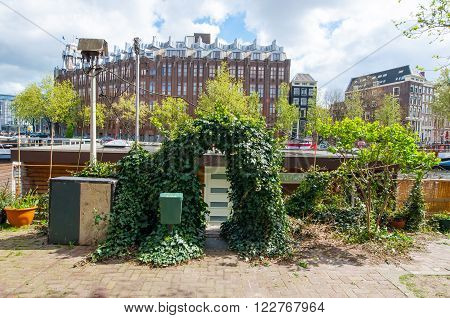 Amsterdam the Netherlands-April 27: Entrance to the traditional Amsterdam houseboat on April 272015. Amsterdam is the most populous city of the Kingdom of the Netherlands.