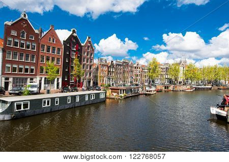 Amsterdam the Netherlands-April 27: Amsterdam cityscape with boat houses on April 272015. Amsterdam is the most populous city of the Kingdom of the Netherlands.