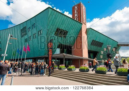 AMSTERDAM-APRIL 27: Science Center and Museum Nemo tourists go sightseeing on April 272015. Science Center Nemo is a science center in Amsterdam Netherlands.