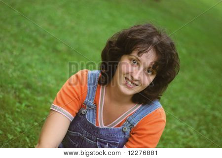 A Young Wooman On Green Grass