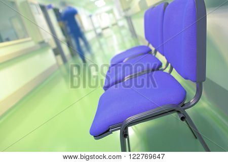 Blurred figure of a person in hospital corridor