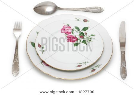 Plate And Table Utensils Isolated On White