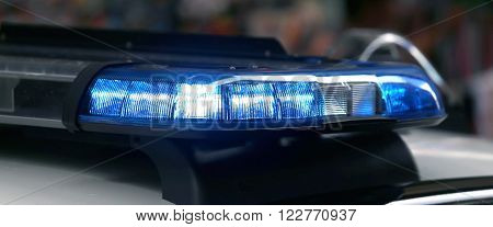 Police Patrol Car With Flashing Lights And Siren
