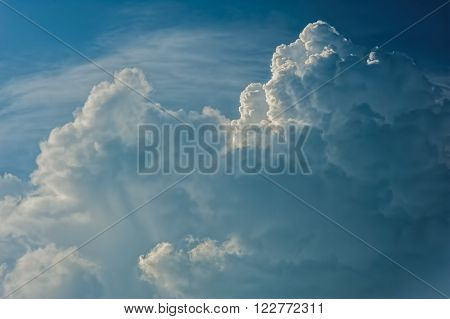 Large fluffy cloud relief details on blue sky