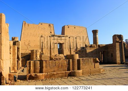 KARNAK, EGYPT - FEBRUARY 5, 2016:Entrance with pillars and ruins showing carvings of gods and heiroglyphs written on the walls in Ancient Egypt at Karnak Temple