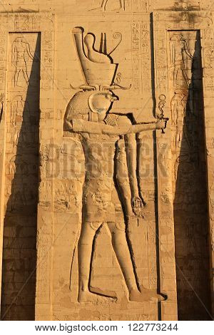 KARNAK, EGYPT - FEBRUARY 5, 2016: Large carving of Horus with heiroglyphs written on the walls in Ancient Egypt at Karnak Temple