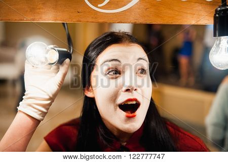 Woman Mime With Playing In Electric Light Bulbs