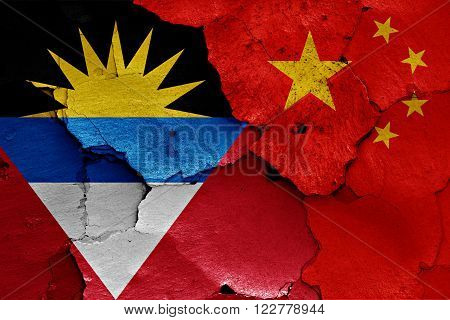 Flags Of Antigua And Barbuda And China Painted On Cracked Wall