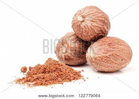 Three nutmeg whole and powder isolated on white background.