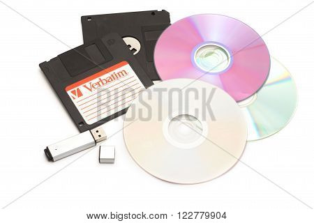 DIKANKA UKRAINE - NOVEMBER 26 2015: Set of different computer storage devices for data and information including a CD-DVD floppy disc USB key