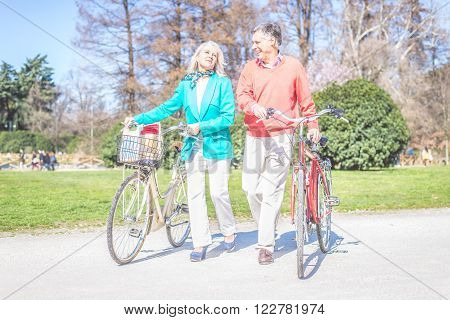 Senior couple on country bike ride - Mature couple of lovers having a walk outdoors