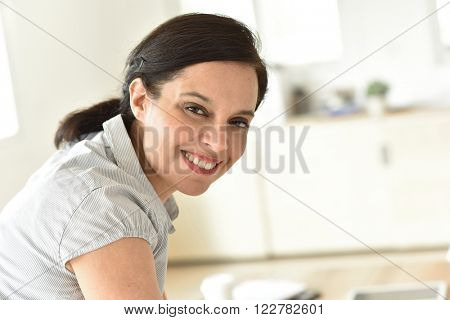 Portrait of smiling 40-year-old business woman