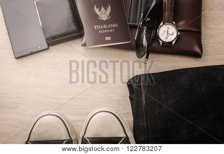 Outfit of traveler Different objects on wooden background Vintage style
