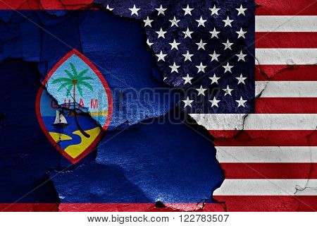flags of Guam and USA painted on cracked wall