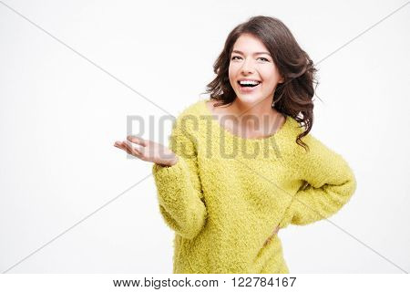 Happy woman holding copyspace on the palm isolated on a white background