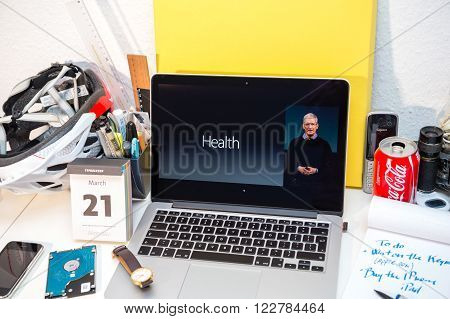 PARIS FRANCE - MARCH 21 2016: Apple Computers website on MacBook Pro Retina in a creative room environment showcasing Apple Event with Tim Cook talking about health