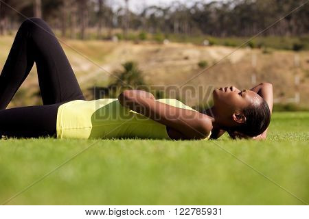 Young Black Sports Woman Lying Down On Grass