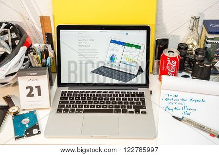 PARIS FRANCE - MARCH 21 2016: Apple Computers website on MacBook Pro Retina in a geek creative room environment showcasing the newly announced iPad Pro and its new keyboard
