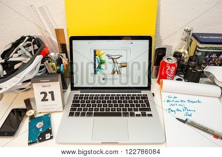 PARIS FRANCE - MARCH 21 2016: Apple Computers website on MacBook Pro Retina in a geek creative room environment showcasing the newly announced iPad Pro and Concepts scetch app