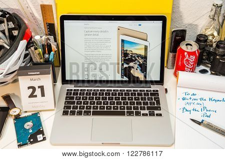 PARIS FRANCE - MARCH 21 2016: Apple Computers website on MacBook Pro Retina in a geek creative room environment showcasing the newly announced 12 Megapixels camera on iPad Pro