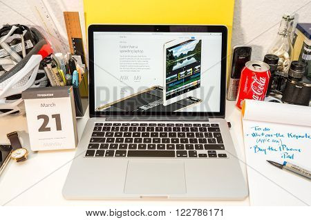 PARIS FRANCE - MARCH 21 2016: Apple Computers website on MacBook Pro Retina in a geek creative room environment showcasing the newly announced iPad Pro and the A9x chip