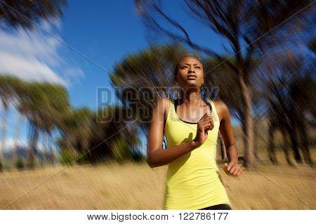 Healthy Young African Woman Running Outdoors