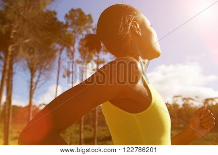 Fit African Woman Running Outdoors On A Sunny Day