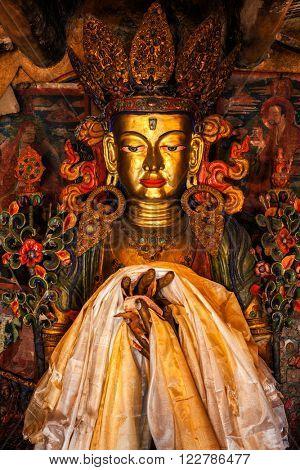 Maitreya Buddha statue close up Tibetan monastery Thiksey Gompa. Ladakh, Jammu and Kashmir, India
