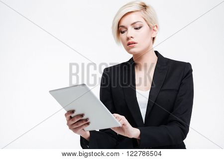 Charming businesswoman using tablet computer isolated on a white background