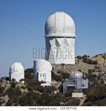 TUCSON, ARIZONA, FEBRUARY 28. Kitt Peak National Observatory on February 28, 2016, near Tucson, Arizona. A view of four of the large telescopes at Kitt Peak National Observatory near Tucson Arizona.