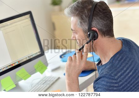 Closeup of telemarketing worker in office