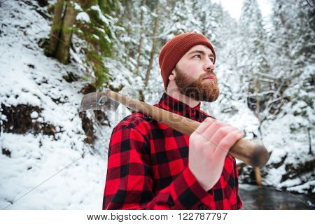 Man holding shovel outdoors with snow on background