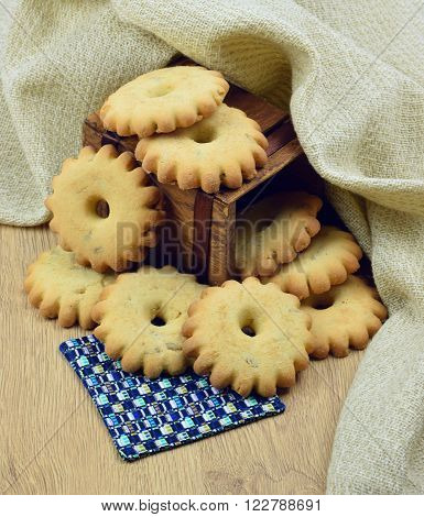 Freshly baked homemade  cookies  with peanuts and raisins on  wooden table . A box of homemade cookies: Christmas present in a rustic style.