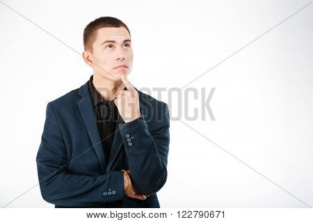 Pensive businessman looking up isolated on a white background