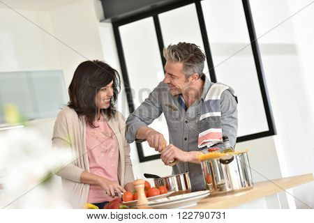 Couple cooking together in modern kitchen