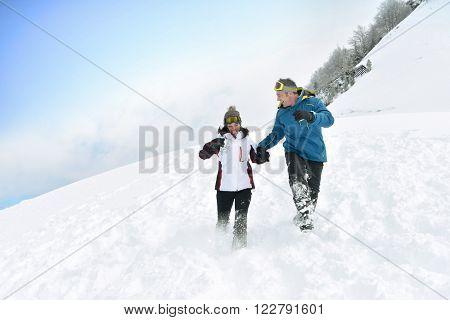Couple having fun running down slope