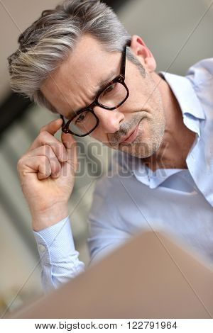 Portrait of handsome businessman with eyeglasses