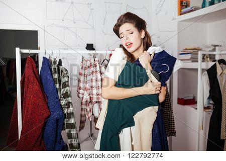 Woman shopaholic choosing dress in store