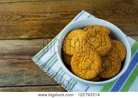 Homemade sesame cookies on rustic background. Breakfast cookie.Dessert. Breakfast. Sweet cookie. ** Note: Soft Focus at 100%, best at smaller sizes
