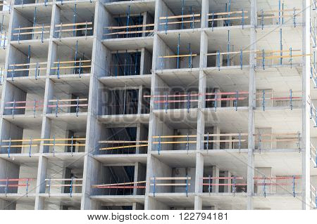 Monolithic frame construction of the building. Solid walls of concrete. Formwork for walls made of concrete. Construction of the building. Masonry walls and aerated concrete masonry walls