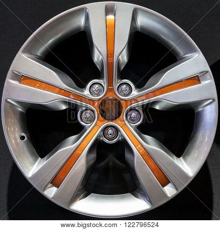 Car alloy rim on black background