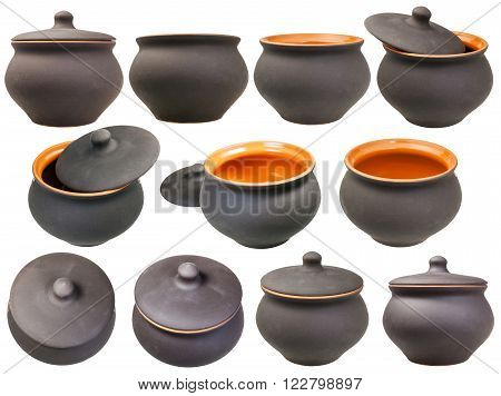 set of ceramic pots from black unglazed clay isolated on white background
