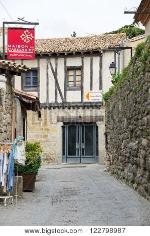 CARCASSONNE FRANCE - MAY 05 2015: Street with medieval houses in old town of Carcassonne Languedoc-Roussillon France
