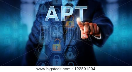 Corporate cyber crime victim touching APT on a virtual screen. Information technology and computer security concept for Advanced Persistent Attack which is an ongoing hacking process or cyber threat.