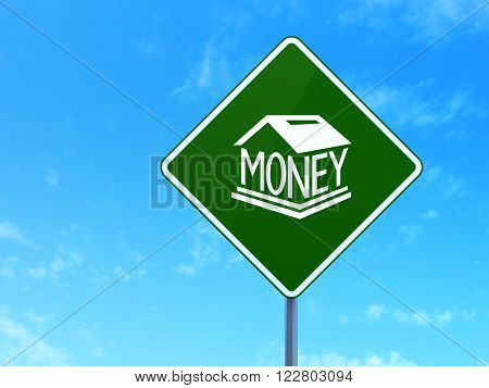 Money concept: Money Box on road sign background