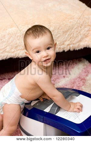 Cute Caucasian Baby With Vacuum Cleaner