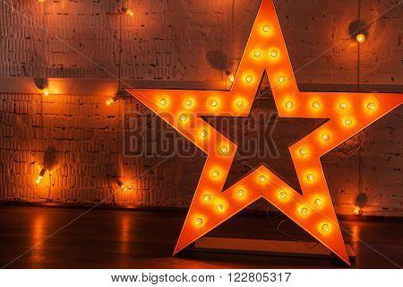 golden star with light bulbs