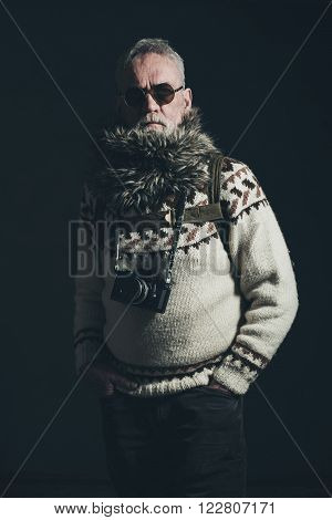 Vintage Old Mountaineer With Knitted Sweater, Fur Collar And Slr Camera.